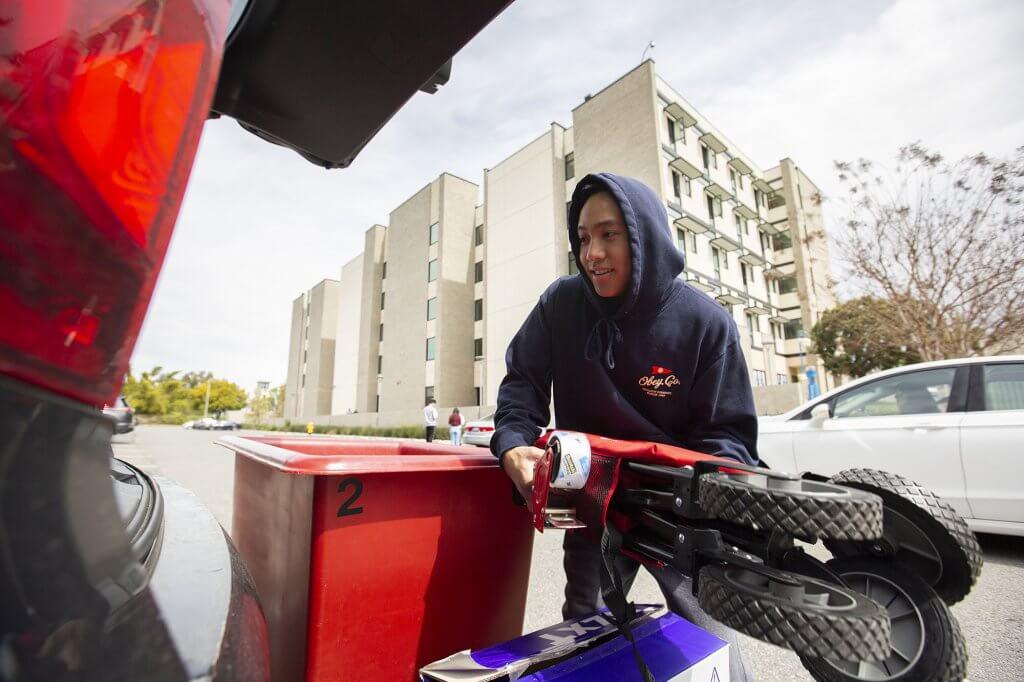 Freshman Sean Labitigan packs up his dorm room belongings