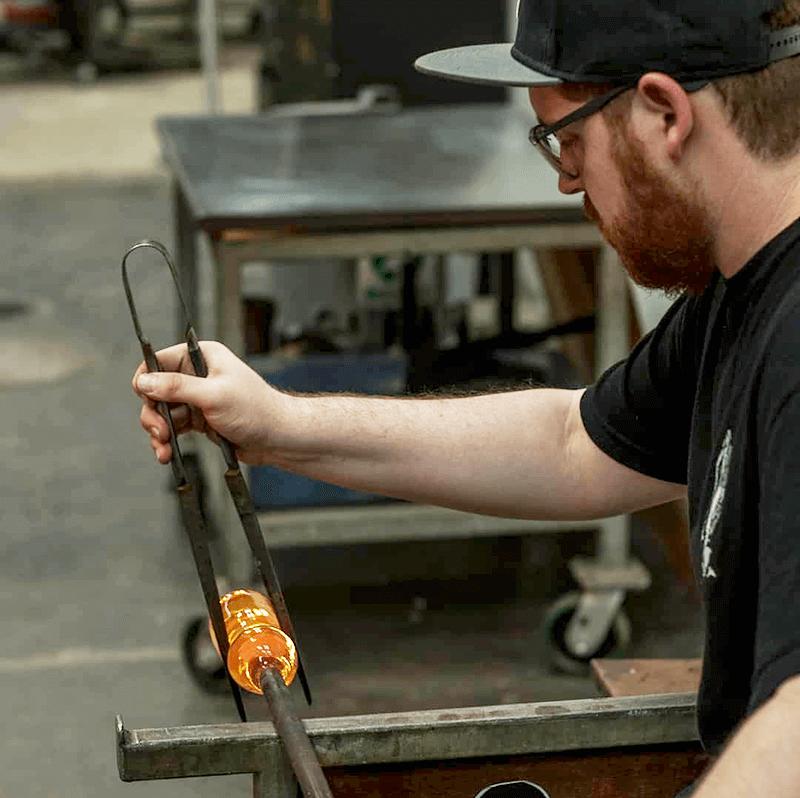 Alex Dixon 1 working on glass art project COVID-19