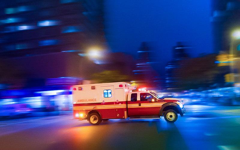 ambulance driving on a city street