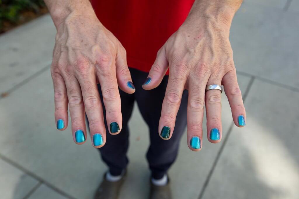 Jon Bruschke's blue painted nails